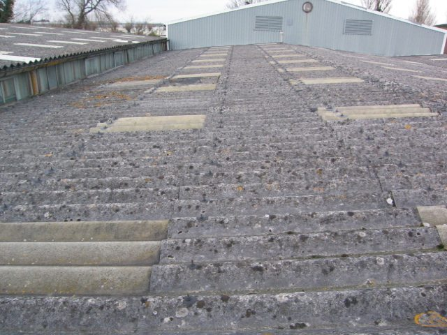 Before asbestos roof cleaning